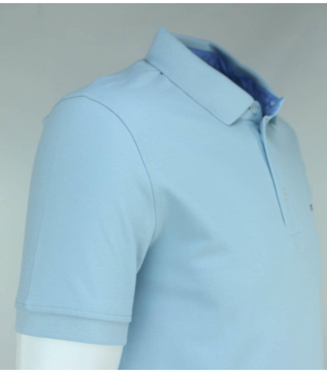 Светло-голубая футболка поло Tommy Hilfiger T3